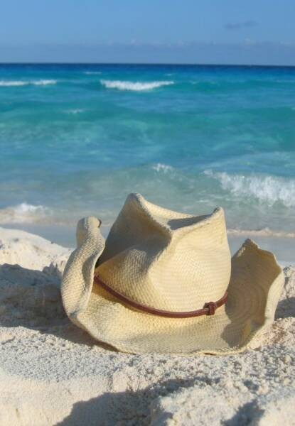cowboy hats on the beach