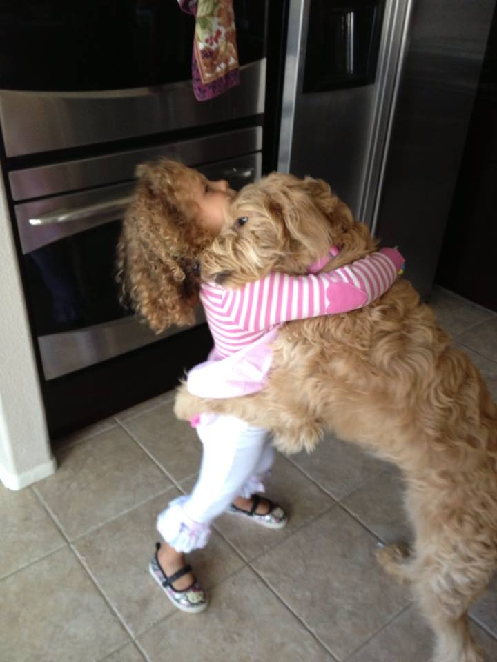dog and girl hugging