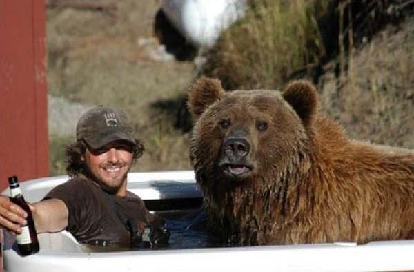 man and bear are best friends