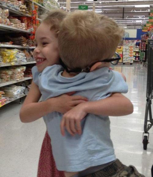 boy and girl hugging grocery store