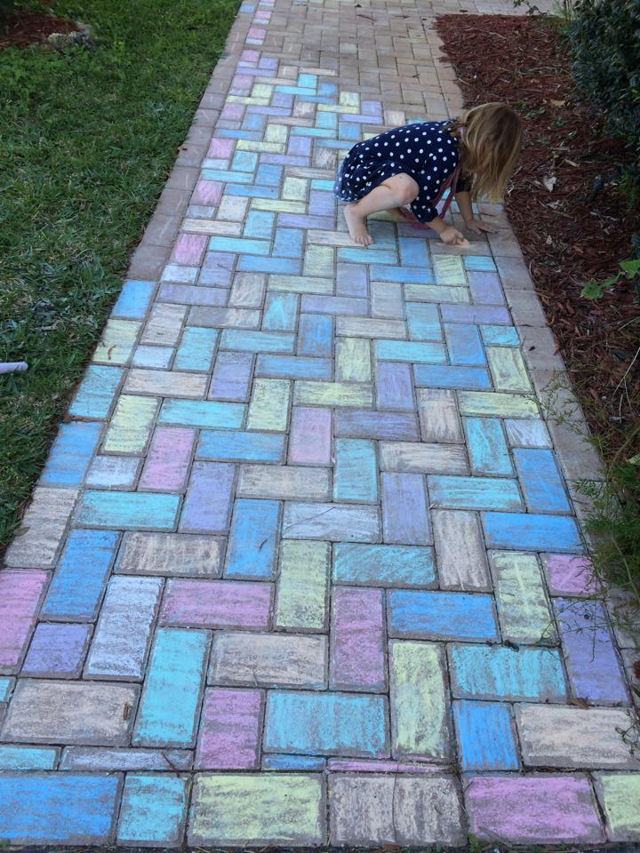 girl sidewalk chalk bricks