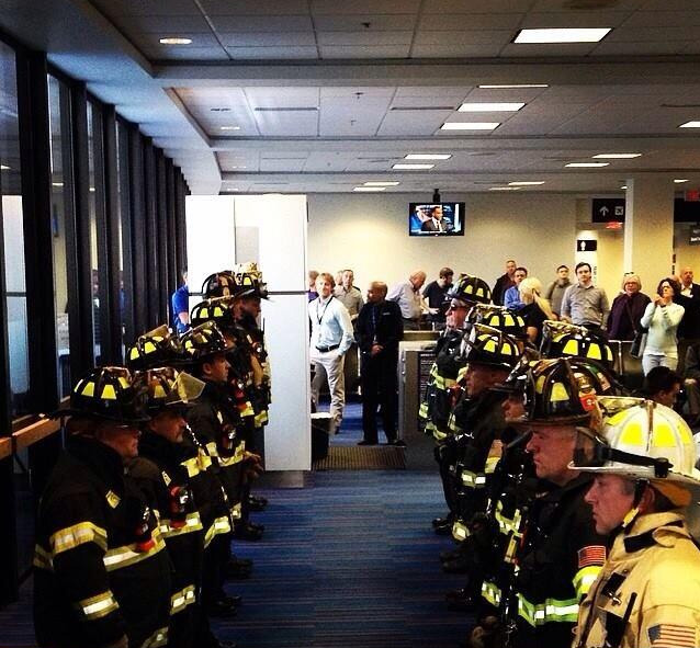 Boston firefighters line up for fallen mother