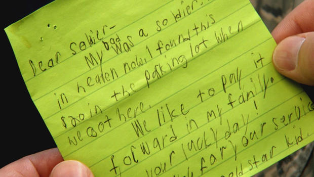 boy gives note to soldier