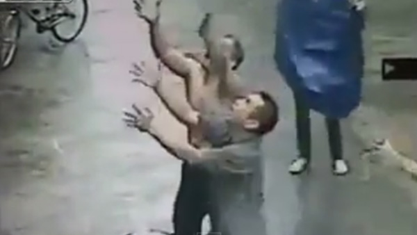 man catches baby in China