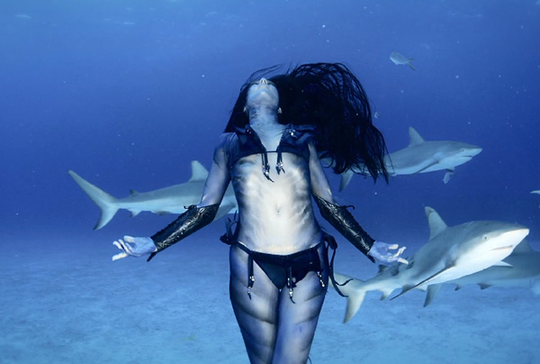 woman dances with sharks
