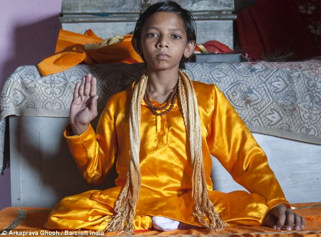indian kid with tail worshipped