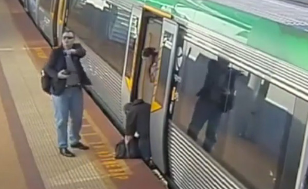 man stuck on train saved by people