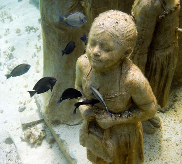 haunting underwater statues