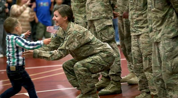 toddler runs into moms arms military