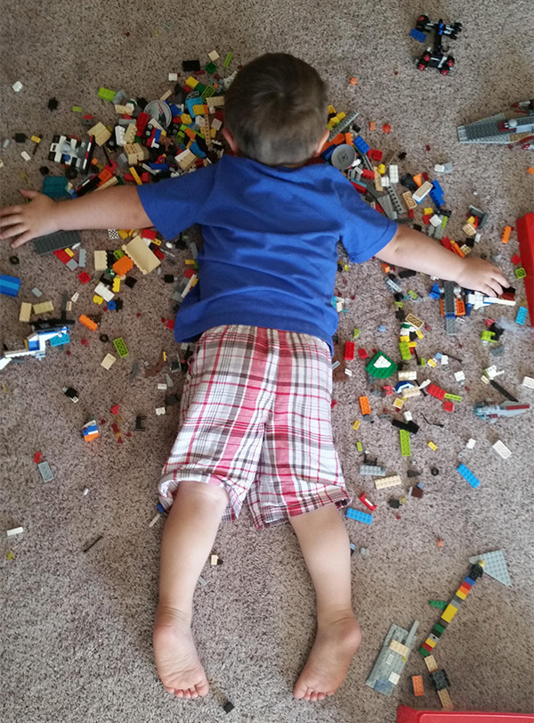 kid asleep on legos