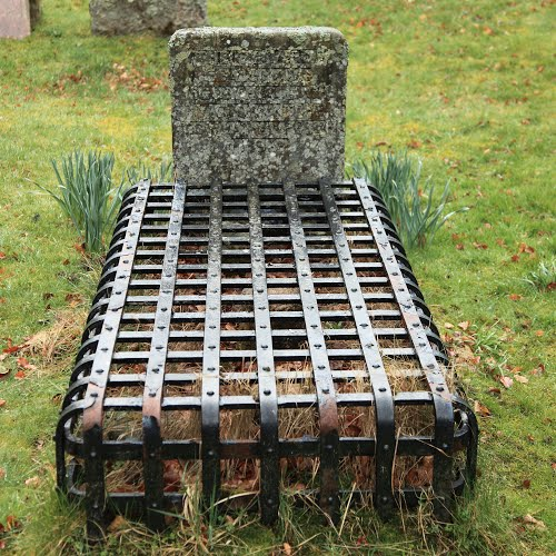 cage over grave