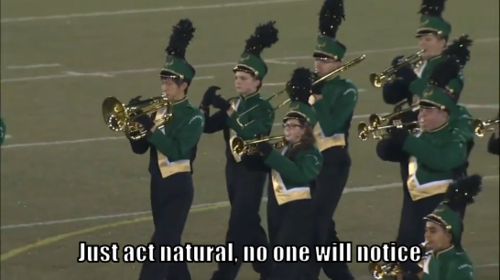 marching band kid pretends to play instrument