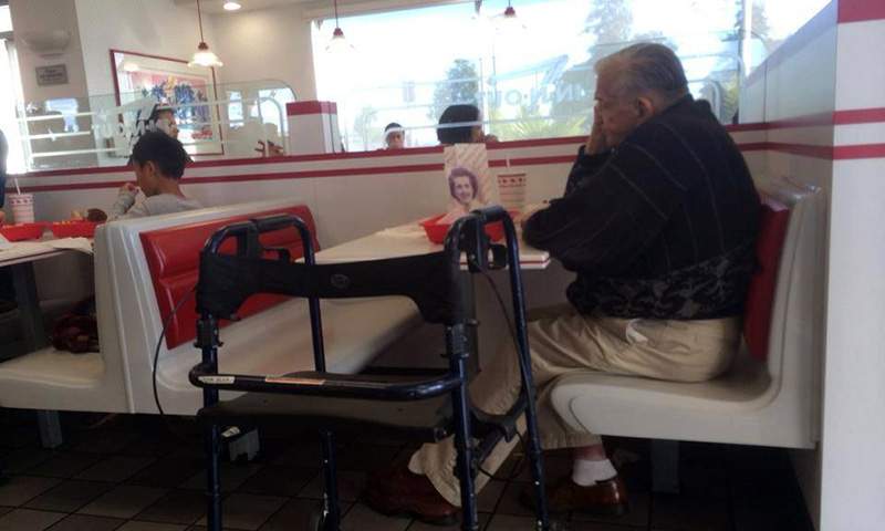 old man eats alone with wifes picture