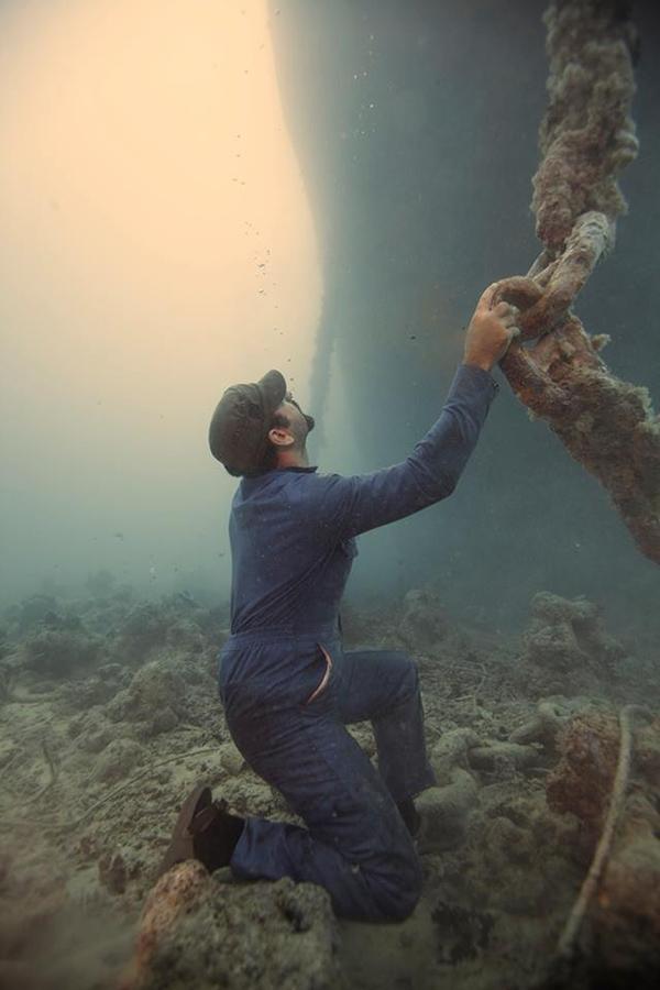 underwater photo shoot construction worker