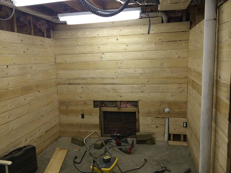 This guy spent 100 turning a basement room into a rustic for Best way to build a basement