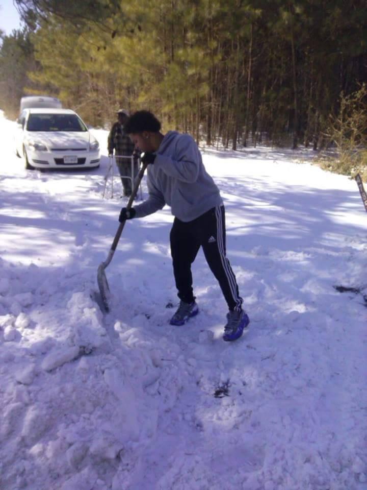 tommy shoves snow elderly man