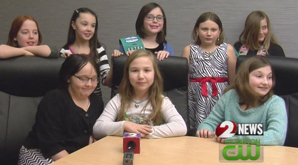girl scouts give money raised to woman who lost home