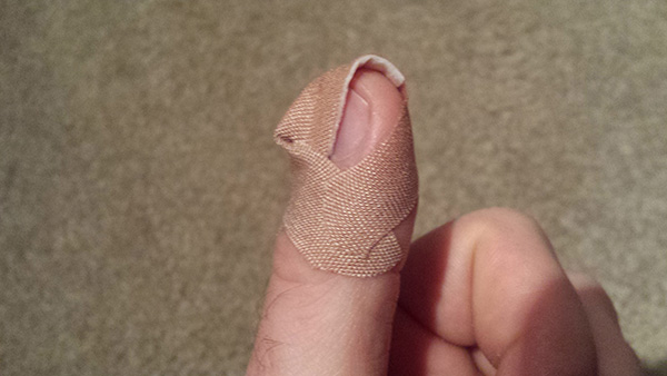 how to bandage a finger so it stays on