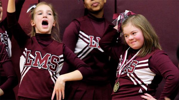 boys stop game to help bullied cheerleader