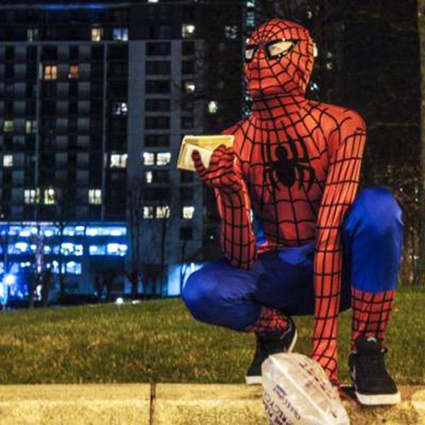spiderman feeding homeless people