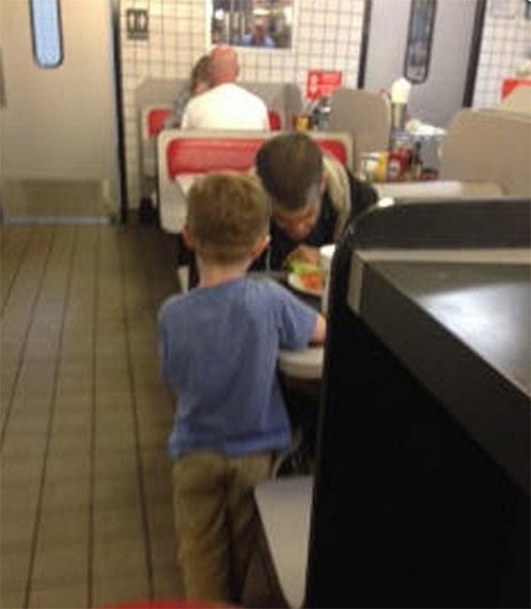 boy feeds homeless man waffle house