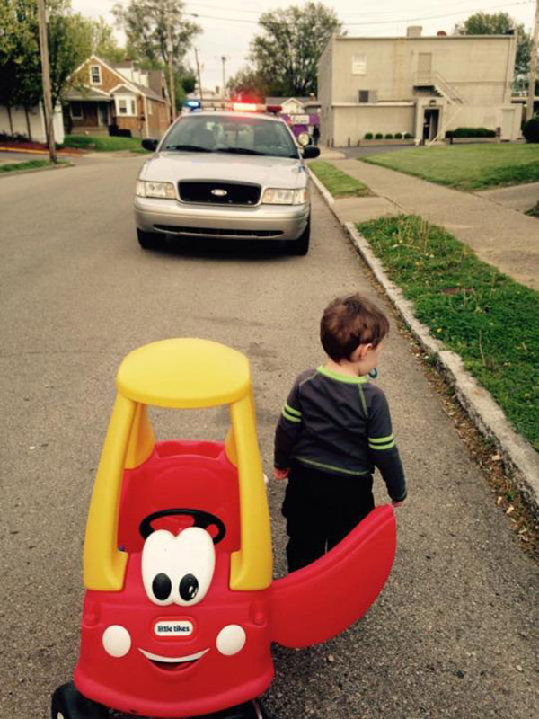 cop pulls over little kid in toy car
