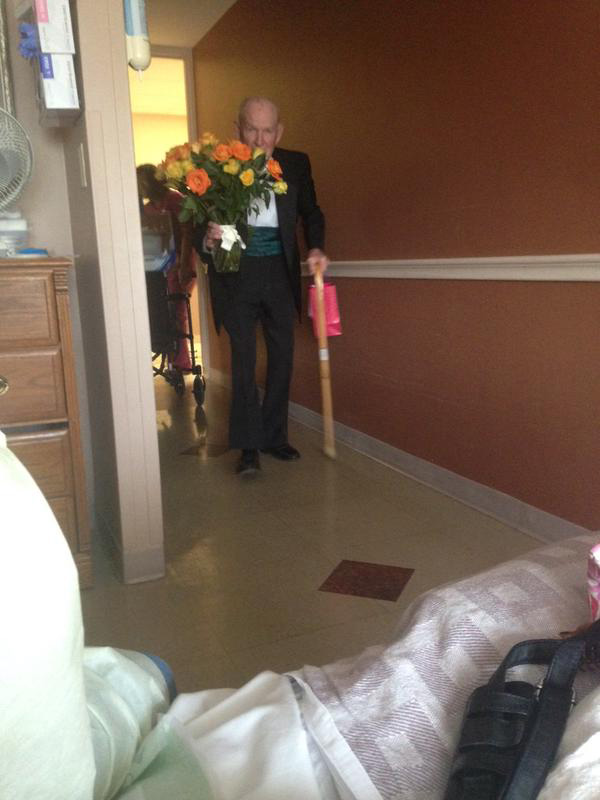 man surprises wife in hospital on anniversary tuxedo