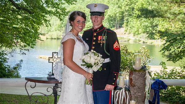 marine and bride praying