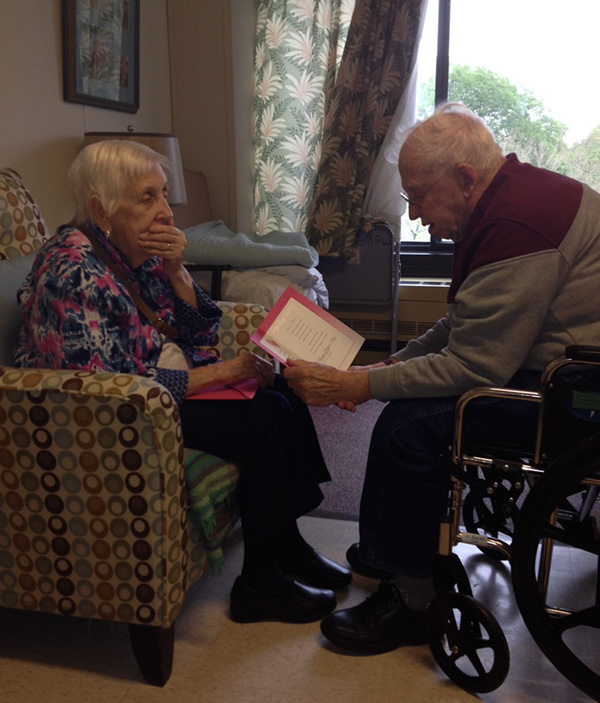 grandpa reads wife mothers day card