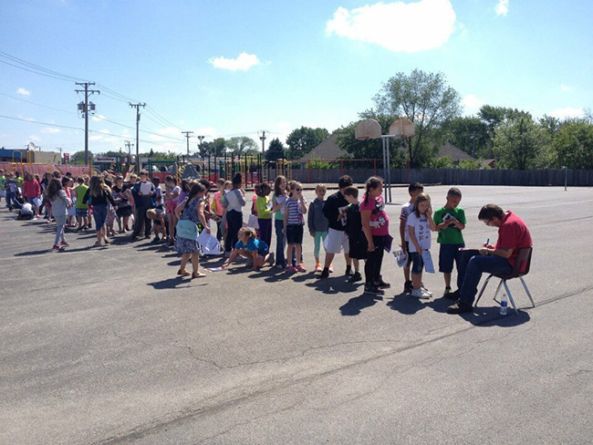 students line up for janitor autograph