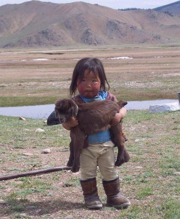 kid holding a kid