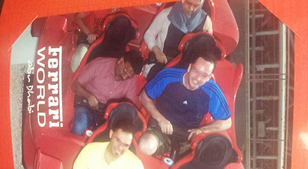 man brings taxi driver on roller coaster