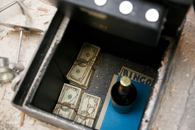 couple finds safe in kitchen with cash