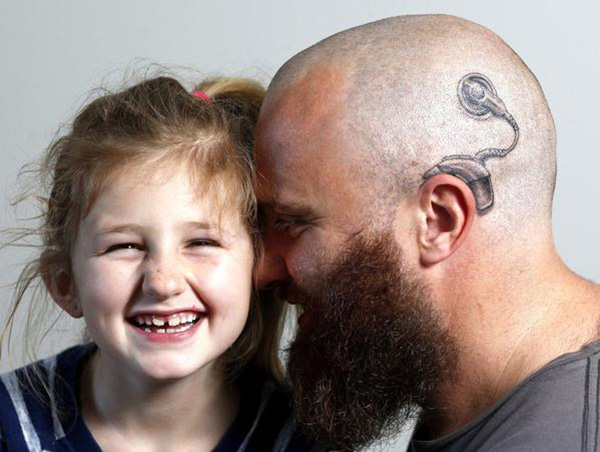 dad gets tattoo of hearing device for daughter