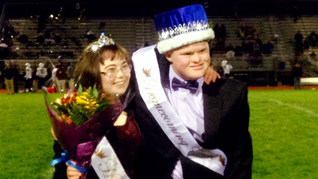 homecoming king leads chant