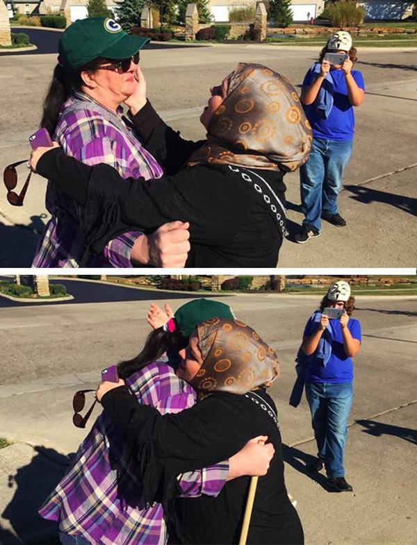 muslim woman hugs protestor