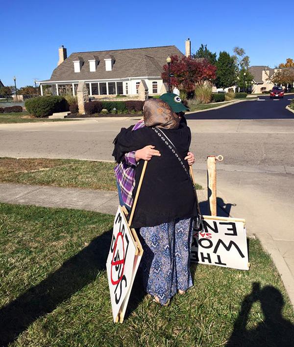woman protesting islam gets hug