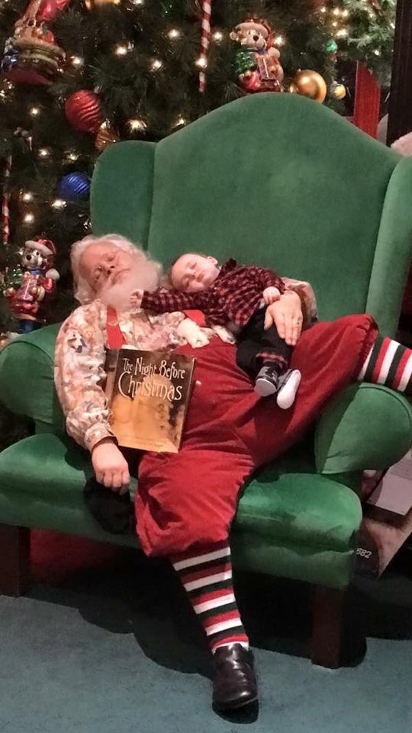 baby falls asleep in line santa