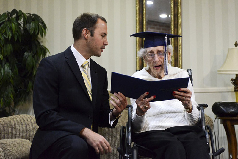 old lady gets diploma