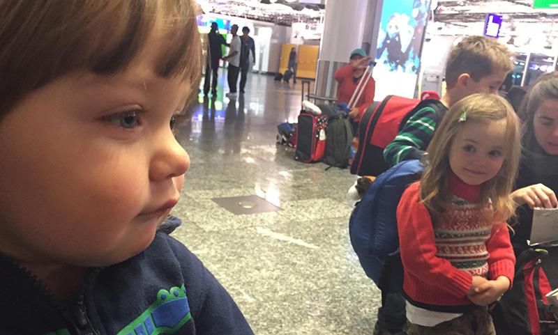little girl gazing at little boy