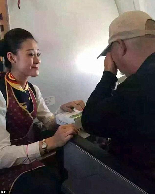 flight attendant feeds disable man