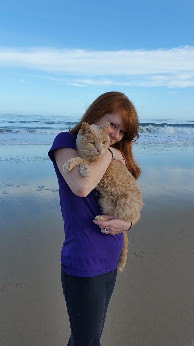 woman takes senior cat on bucket list adventures