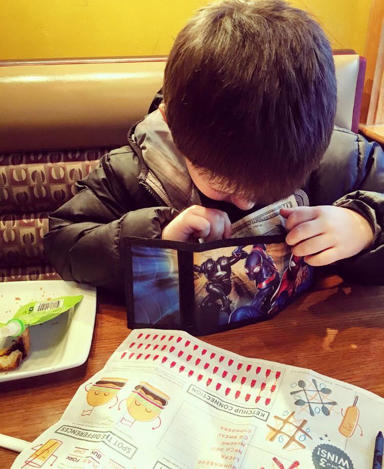 boy treats mom to dinner with allowance money