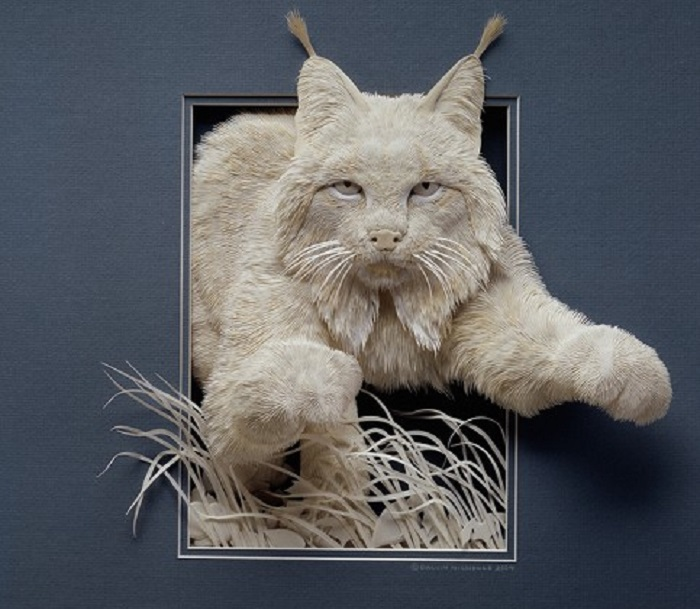 artist makes paper animals