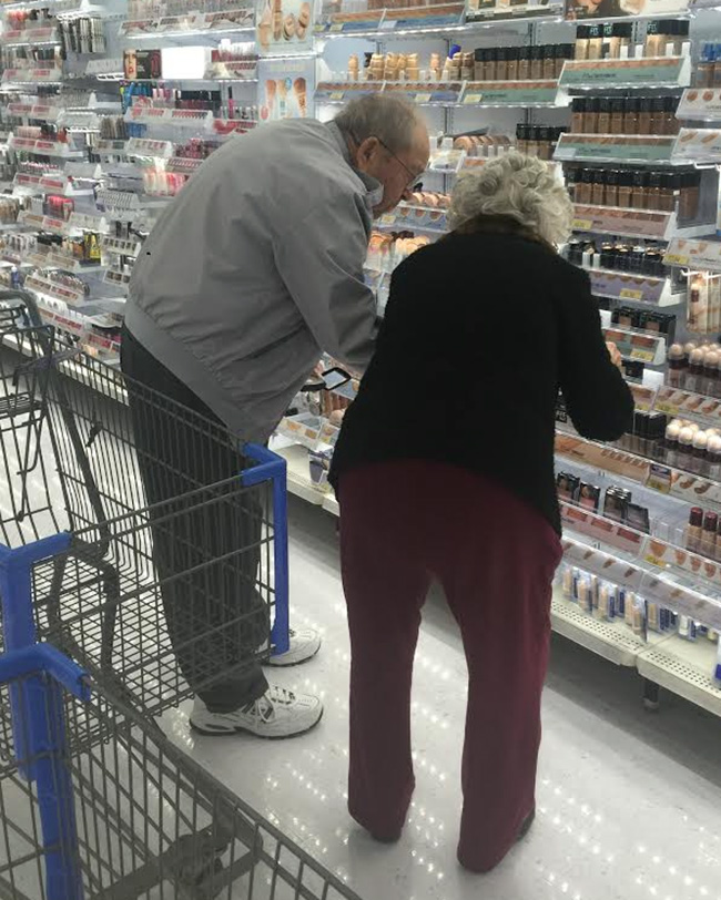 elderly husband helping wife with makeup picture
