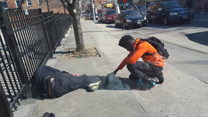 boy praying for homeless man Baltimore