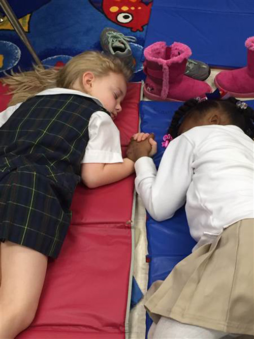 black and white students holding hands sleeping