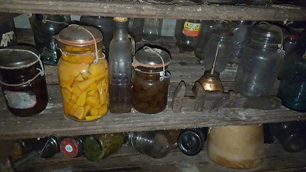 cellar under house old bottles