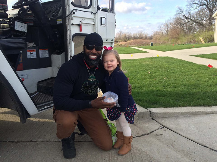 little girl meets garbage man