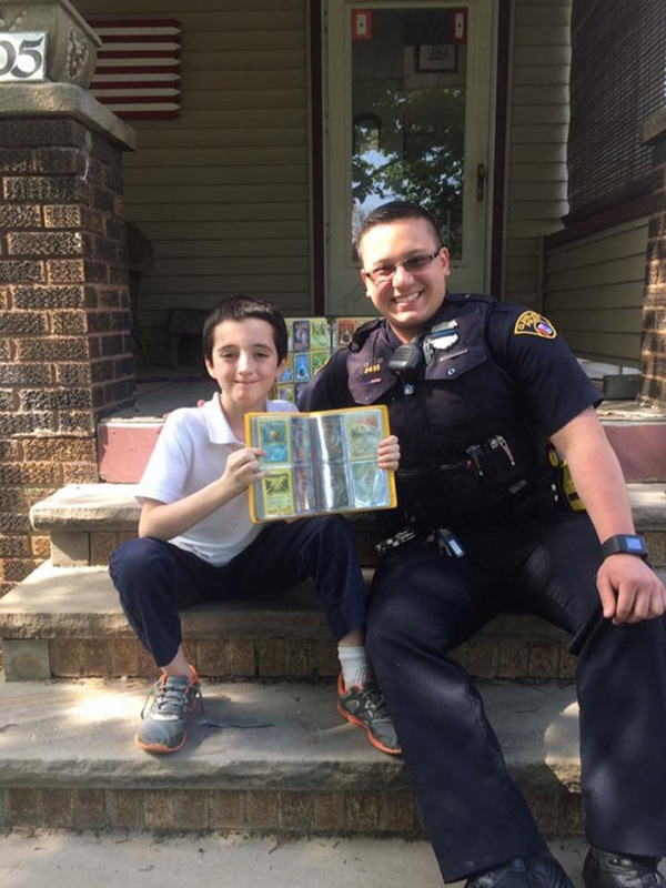 cop brings kid his Pokemon collection after stolen
